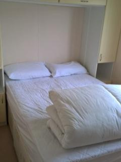 Mater bedroom.  4ft 6' double bed with built in around the bed storage