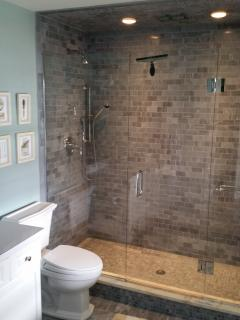 Master bathroom with marble shower with 3 shower heads