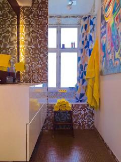 We love a bright bathroom and a big tub!