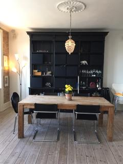 In the lake side region of Østerbro Copenhagen, this spacious apartment is a great spot for families