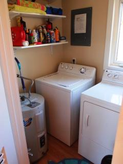 Full-size Automatic Washer and Dryer in Laundry Room next to Kitchen