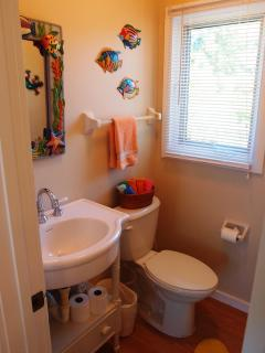 The Powder Room is conveniently located next to Dining/Living Room and Kitchen.