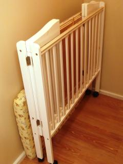 A folding crib is stored in the closet upstairs, and fits in the King bedroom upstairs.