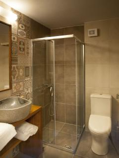The stone sink and quality towels and toiletries are highlights of the Studio's bathroom.
