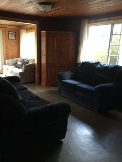LIVING ROOM HAS A COUCH AND 2 LOVESEATS AND THE SUNROOM HAS A SOFA SLEEPER