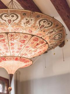 precious Fortuny designer lighting, perfectly fitting into this apartment