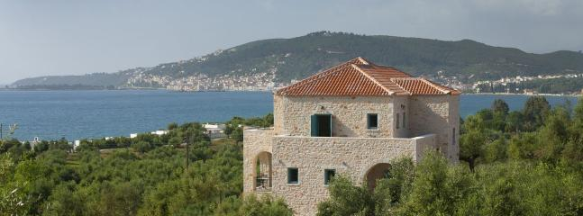 Outside view of The Olive Yard with Gytheion and the Gulf of Laconia as a backdrop.