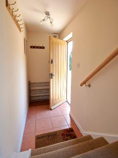 Entrance hallway leading to stairs