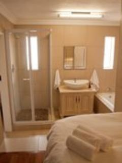 Apartment 1: Main Bedroom with en-suite bathroom with bath and shower