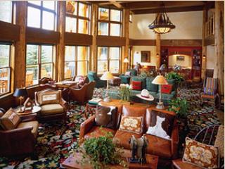 Two story guest greatroom with huge fireplace, bar and bartender, large outdoor deck, & coffee bar