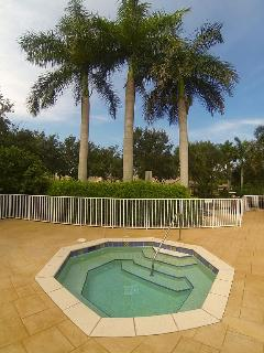 Hot tub is only steps away from the condo.