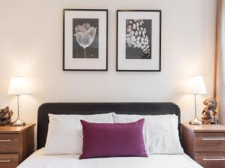 Master bedroom: large king size bed,  fresh linens provided, bedside table and lamp.