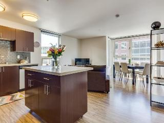 Dog-friendly condo with an ideal location, shared roof decks, a gym & game room!