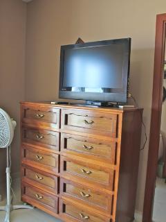 Dresser and flat-screen Tv in second bedroom.