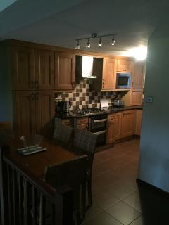 Kitchen and Dining area.  American Fridge Freezer, Washer/Dryer, Dishwasher, microwave, Twin oven.