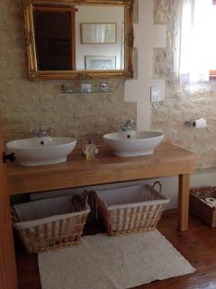 Large family bathroom with  his and hers sinks