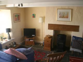 The cosy beamed Sitting Room - with an easy to use gas Provence stove -