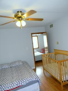bedroom number 2 1 king bed , crib for baby , balcony , night lamp , big closet , fireplace (with ca
