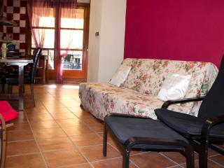 sala/comedor con sofá cama