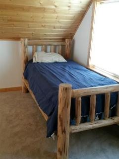 twin bed in cabin loft