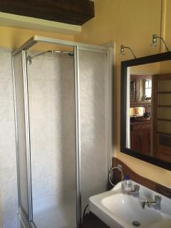 Shower Stall w/ Sliding Glass Doors in Bathroom