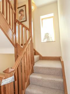 A light oak stairwell connects the three floors of the property.