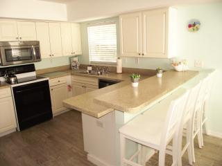 The well equipped kitchen has a dishwasher, microwave and cooker and  fridge freezer.