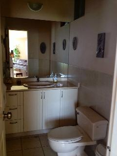 Living room visitor's bathroom with sink and toilet
