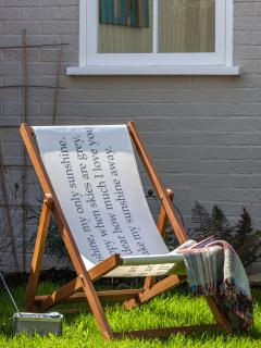Relax in the sunny courtyard garden on our deck chair, with a good book!