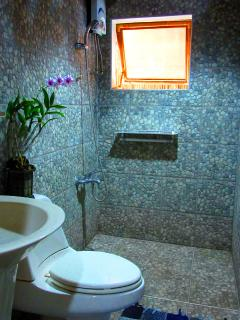 Our beautifully-tiled toilet and baths have hot and natural-cool showers.