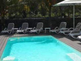 sunbed around pool