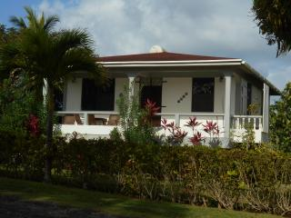 Fully equipped two bedroom cottage with large yard, Calibishie