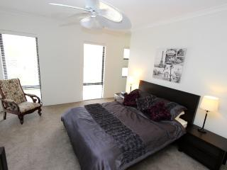 Large main  bedroom with ensuite , walk in robe and tropical fan.