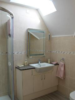 Upstairs shower en-suite to the double bedroom