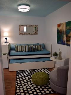 Upper level studio living/sleeping area with twin pull out trundle bed