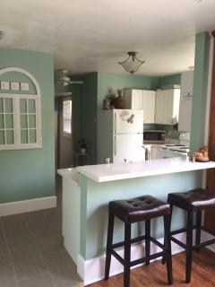 Kitchen is fully stocked w/ pots/pans/dishes stove, oven, microwave, toaster, coffee maker.