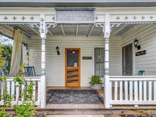 Historic home w/ a cute front & back porch, a cozy fireplace, & more!