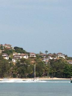 Zoom in view of the villa with a jet ski in foreground.