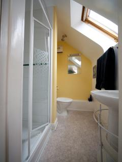 A bathroom off the main bedroom has a shower