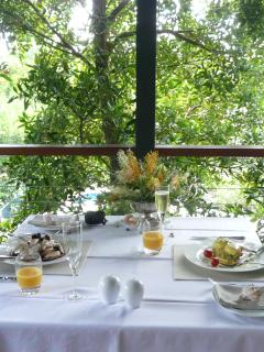 Guests enjoying main course of breakfast on alfresco Dining Deck.