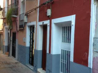 recently renovated 104 - year old ground floor apartment. it is in the orange/grey painted building.