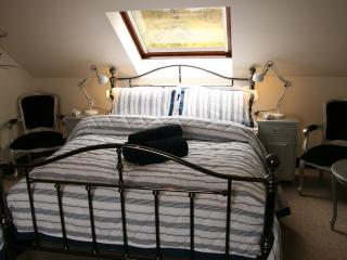 Main bedroom with king size bed and view out to the rear garden.