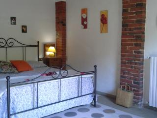 the double bed warm and rustic atmosphere for a relaxing stay