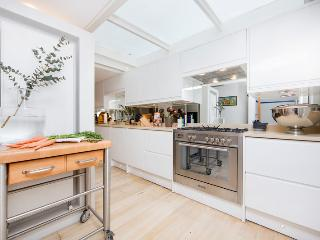 A superb four bedroom town house arranged over four floors with private garden.