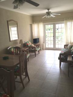 Delightful living area with patio doors to balcony overlooking the clubhouse and pool