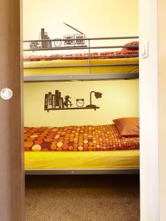 In second room. We put bunk bed. Each mattress is 90x200cm.It is comfy when you are coming with kids