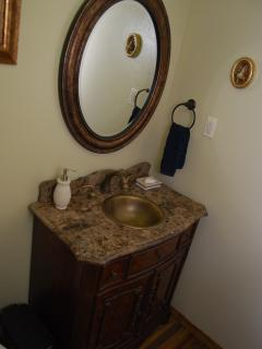 Hall bathroom with antique sink and vanity we found in Durango.