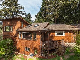 Scenic Cove~ Stroll down a wooded trail to the beach from this spacious home.