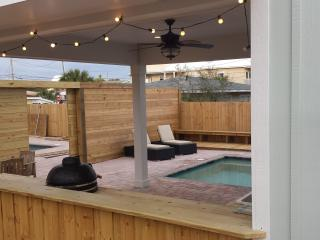 Outdoor kitchen, pool, private yard, outdoor shower & opens up to our back house for double rentals.