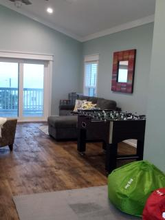 Top floor recreation area has Foosball table, sofa bed, large screen TV and kids play area...
